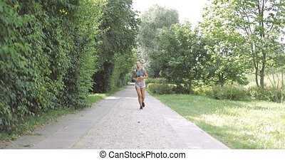 Content woman running in park - Beautiful ethnic woman in...