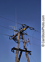 Electric post and blue sky - Typical power lines in Poland....