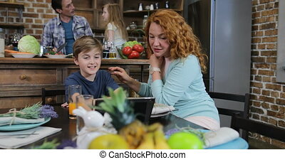 Mother And Son Touch Tablet Screen Browsing Recipe While...