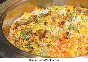 Biryani rice in a large pan