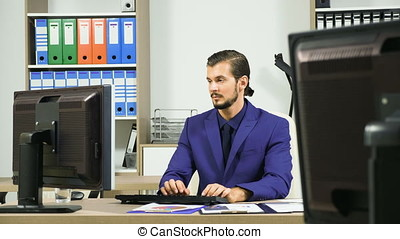 Businessman working in office and typing on the keyboard