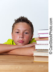 12 years old boy sitting at the table with books - Portrait...