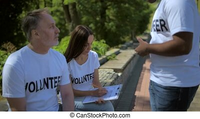 Helpful volunteers expressing their ideas - Good idea....