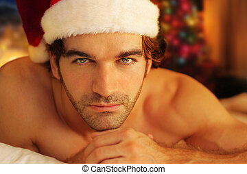 Romantic santa - Young man bathed in warm light from...