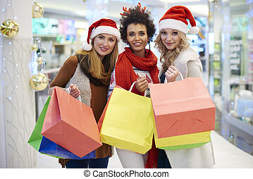 Portrait of cheerful girls at the shopping mall