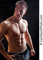 Bodybuilder man isolated on black background Studio shot
