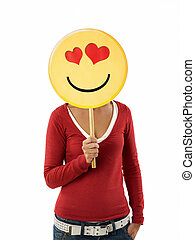 woman with emoticon - young adult woman holding emoticon...