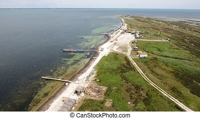 Aerial shot of Dzharylhach island piers and seabeach in...