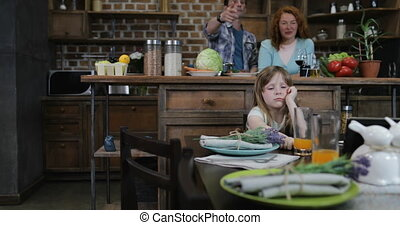 Children Sitting At Dinner Table Waiting For Meal Use Tablet...