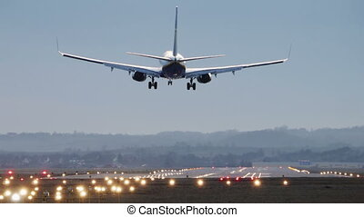 Commercial Airplane Landing in the morning - Boeing 737-800...