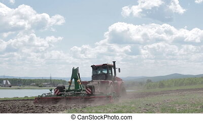 Tractor plowing a field on a beautiful day