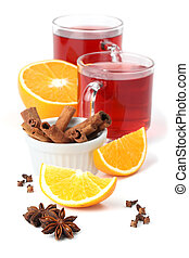 Mulled wine with oranges, cinnamon, anise and clove isolated...
