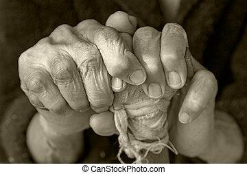 Hands of an elderly woman on a cane - Hands of an elderly...