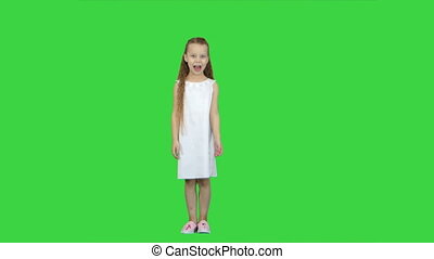 Young lady is dressed up in lovely dress and white shoes...