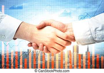 Teamwork and finance concept - Close up of handshake on...