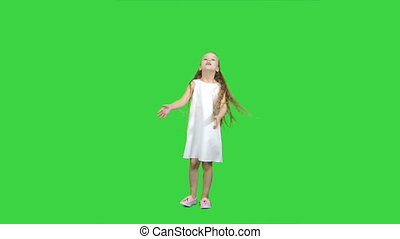 Dancing little blond girl singing on a Green Screen, Chroma Key