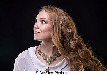 Blond young girl with curly hair