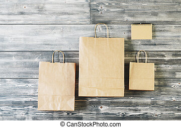 Recyclable concept - Blank brown paper shopping bags hanging...