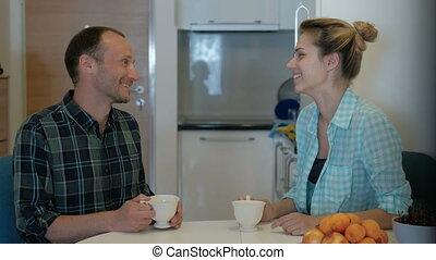 man comes to visit woman, drink tea, talk, discuss personal...