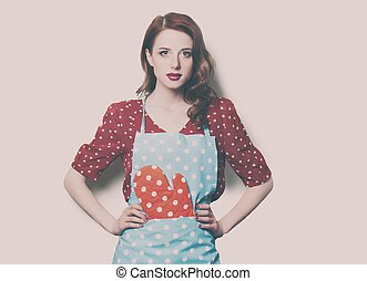 woman in pinafore with potholder - beautiful young woman in...