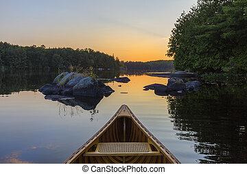 Bow of a cedar canoe at sunset - Haliburton, Ontario, Canada