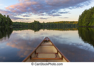Bow of a canoe on a lake in Ontario, Canada - Bow of a canoe...