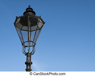 Streetlamp - Period styled cast iron streetlamp against a...