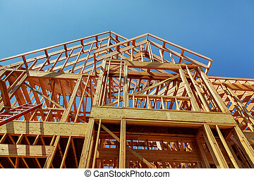 wood framework of new residential home under construction.