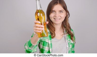 Young woman with bottle of beer - Teenager with bottle of...