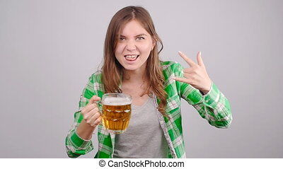 Crazy Young woman with a mug of beer