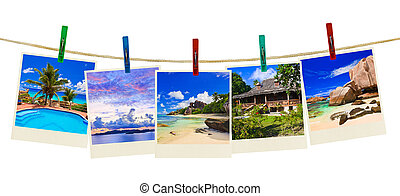 Vacation beach photography on clothespins isolated on white...