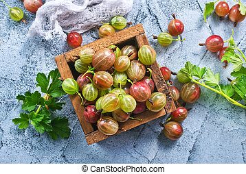 gooseberry in wooden box and on a table