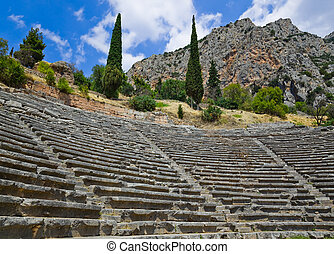 Ruins of amphitheater in Delphi, Greece - archaeology...