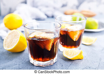 cuba libre - kuba libre in glass and on a table