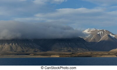 cruising through arctic isfjord in svalbard