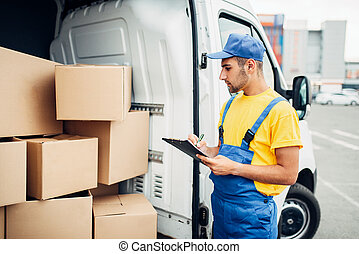 Cargo delivery, male courier with box in hand - Cargo...