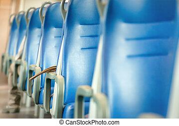 Empty blue seats in european modern train