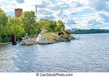 Wreck of abandoned sink ship near river coast