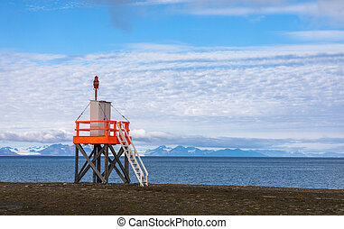 Tower at the beach next to airport at Svalbard, ocean and...