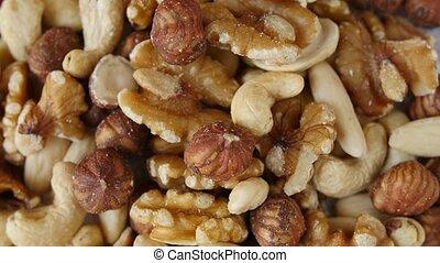 Close up of mixed nuts rotating.