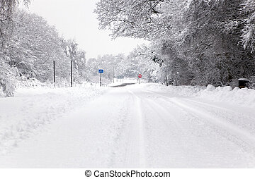 Snow covered road - A snow covered road with No Entry and...