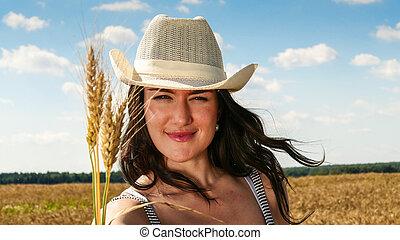 Pretty woman in the field close up portrait - Pretty woman...