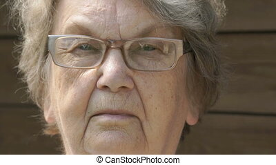 Portrait of serious old gramma aged 80s outdoors - Portrait...