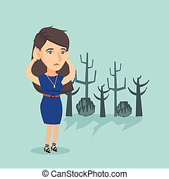 Young caucasian woman standing in a dead forest. - Young...