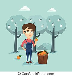 Young caucasian farmer collecting oranges. - Young caucasian...