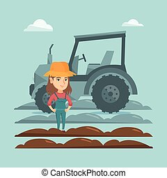Farmer standing on the background of tractor. - Caucasain...