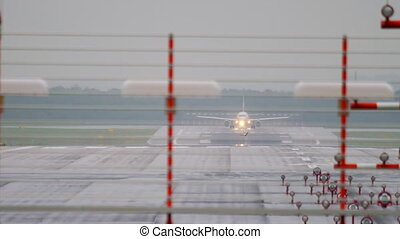 Airplane departure at rainy weather, early morning,...