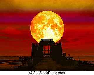 super full blood moon over abandon temple in the sea,...
