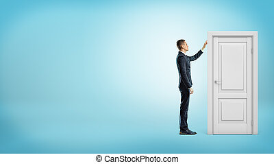 A businessman on blue background touches a white doorframe with a closed door inside.