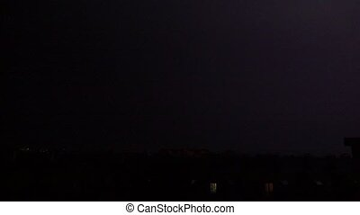 Lightning in town at night - Super slow motion shot of a...
